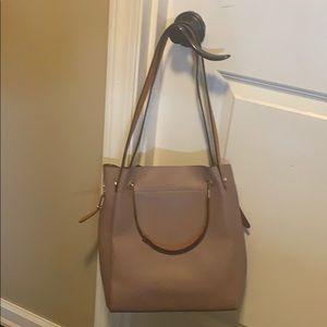 Mauve colored bag, handbag or medium length strap